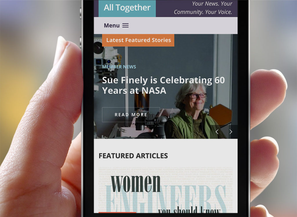 ATG - All Together Blog - Society of Women Engineers - on an iPhone in a hand