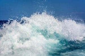 Water splashing in the ocean - BlueWater Communications acqusition