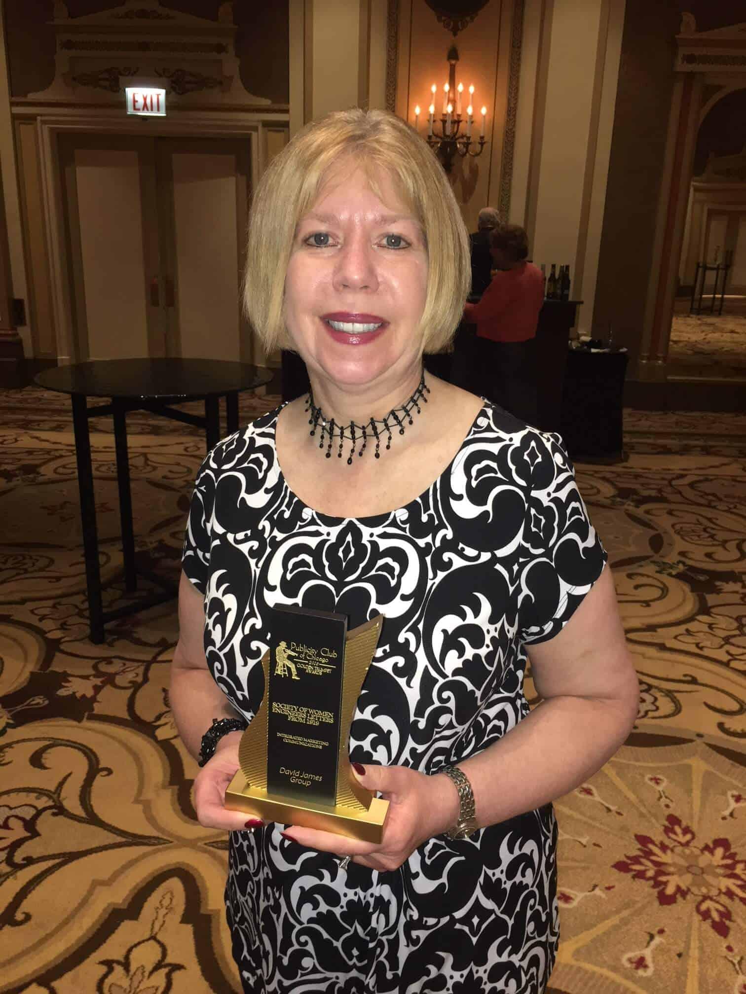 Karen Horting, SWE's CEO, receives the Golden Trumpet Award
