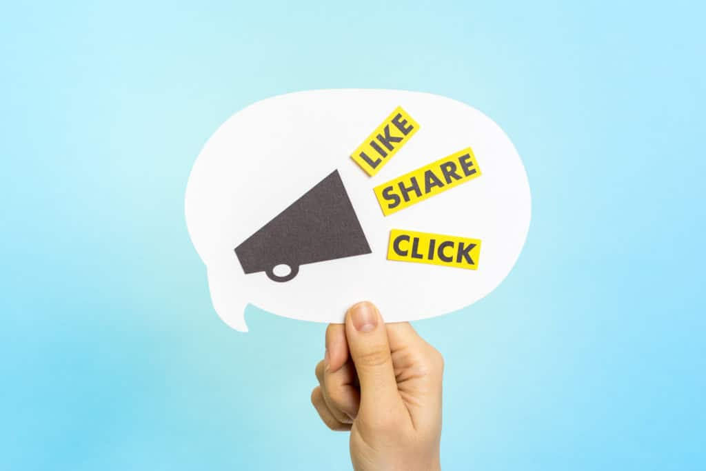 "Social media messages: ""LIKE"" ""SHARE"" ""CLICK"" on speech bubble. Social Media Engagement"