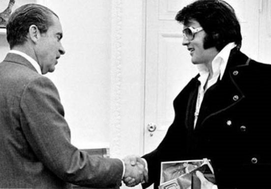 Elvis and Nixon shaking hands in the art of the shake