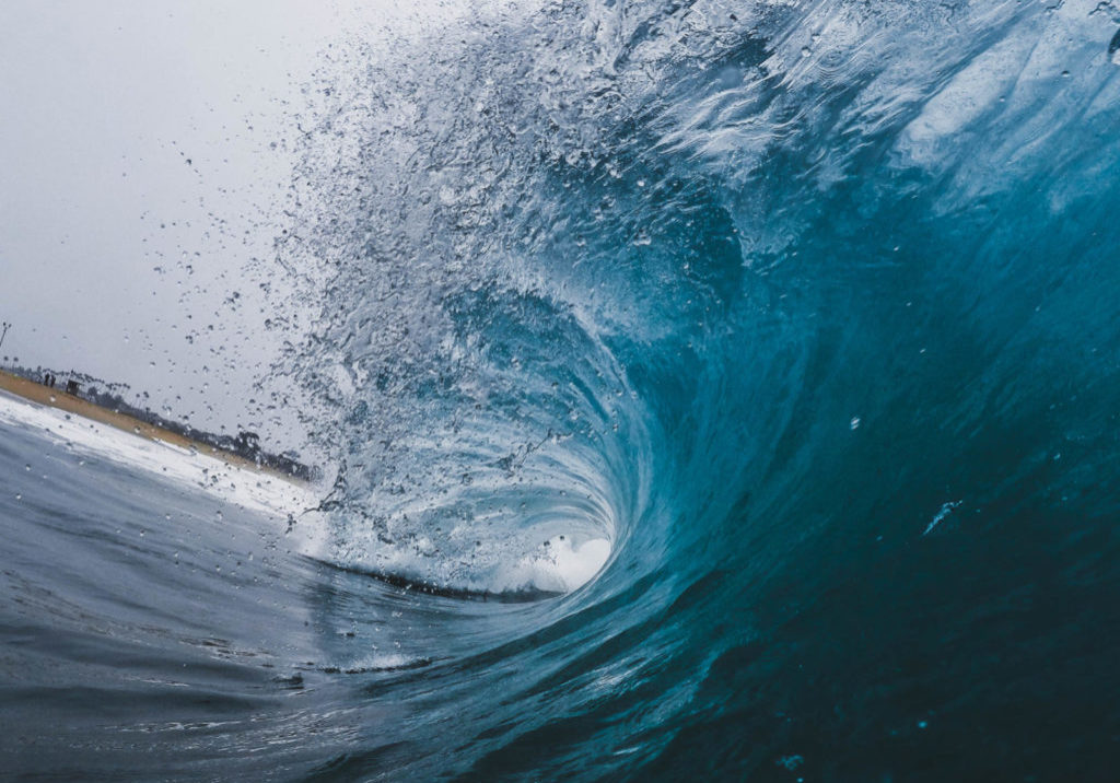 A photo of a wave turning over within the ocean